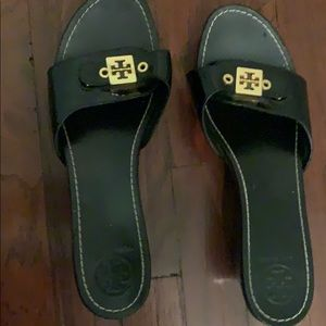 Tory Burch black wedge slides.